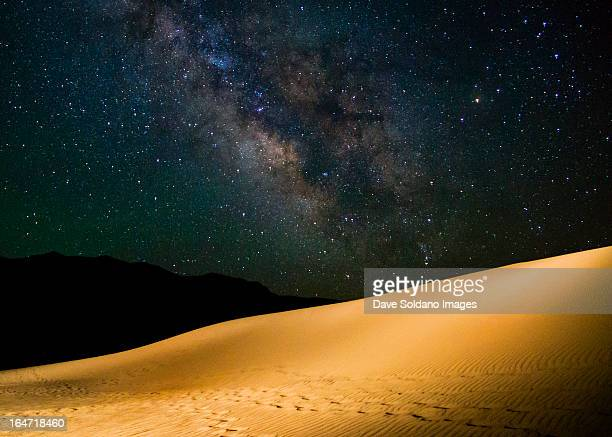 milky way over great sand dunes - great sand dunes national park stock pictures, royalty-free photos & images