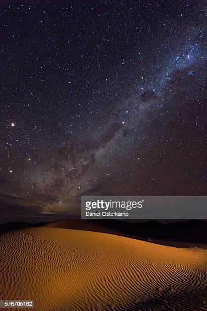 Milky Way over illuminated sand dunes in the namib desert, Sossusvlei, Namibia, Africa