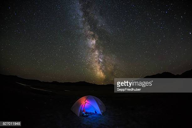 Milky way over illuminated tent in Mongolia