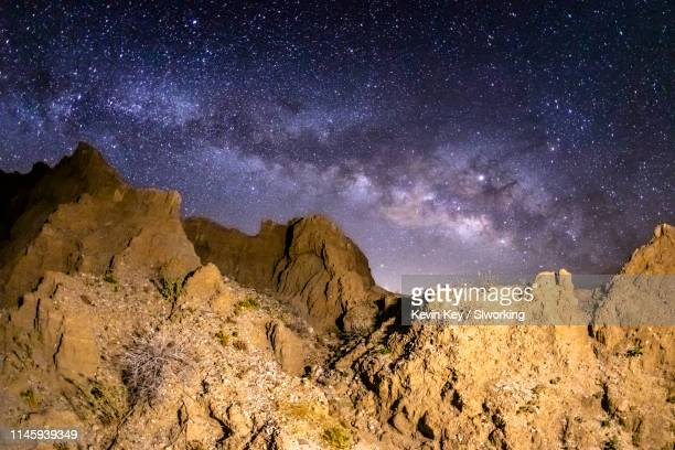 milky way over marslike badlands in the anza-borrego desert - anza borrego desert state park stock pictures, royalty-free photos & images