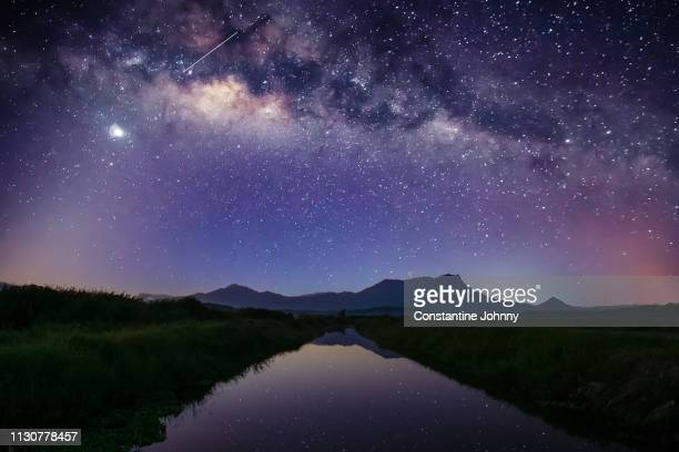 milky way over mount kinabalu - atmospheric mood stock pictures, royalty-free photos & images