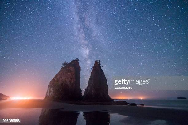 milky way over rialto beach in olympic national park - rialto beach stock photos and pictures
