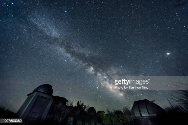 milky way over saji observatory telescope buildings in japan - tottori prefecture stock photos and pictures