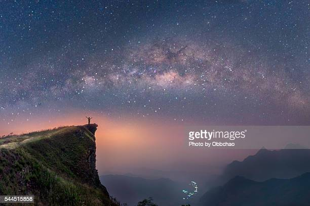 milky way over the mountains of chiang rai, thailand, phuchifha - celebrities photos stock pictures, royalty-free photos & images