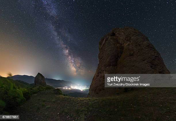Milky Way over the shining town of Veseloe in Russia.