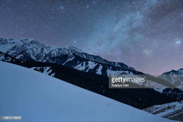 milky way over the snowy mountains - nebula stock pictures, royalty-free photos & images