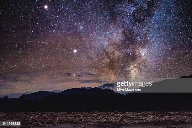 milky way over the southern alps - saturn planet stock photos and pictures