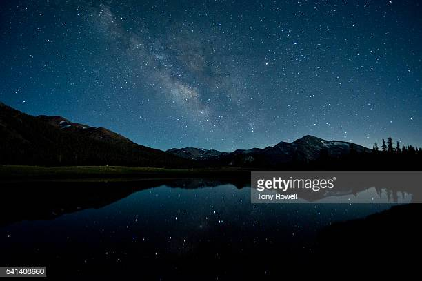 milky way reflecting in seasonal pond at 9,000 feet in tuolumne meadows, yosemite national park, california, usa - star field stock pictures, royalty-free photos & images