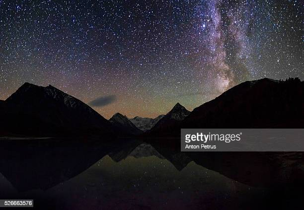 milky way reflection in mountain lake - anton petrus panorama of beautiful sunrise stock pictures, royalty-free photos & images