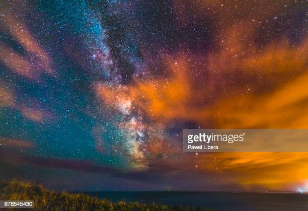 milky way rising over dorset's jurassic coast. - space exploration stock photos and pictures