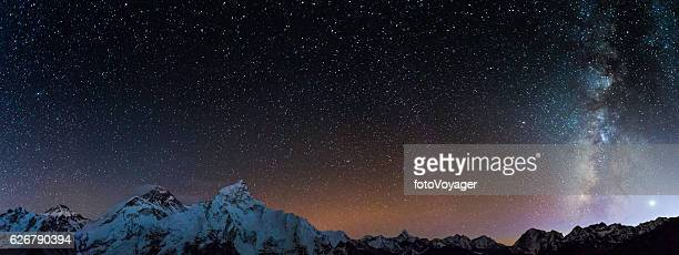 Milky Way stars shining Mt Everest summit Himalaya mountains Nepal