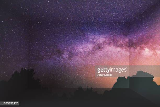 milky way with starry sky at night inside home using virtual reality simulator. - galaxy stock pictures, royalty-free photos & images