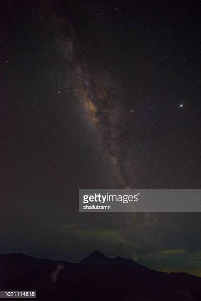 milkyway above mount bromo . mount bromo is part of the bromo-tennger-semeru national park located in east java of indonesia. - shaifulzamri stock pictures, royalty-free photos & images