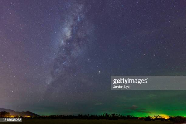 milkyway over the field - galaxy stock pictures, royalty-free photos & images