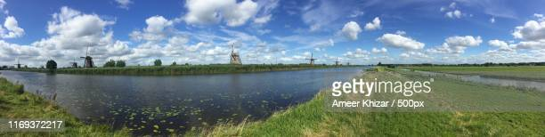mill network at kinderdijk-elshout, netherlands - panoramic stock pictures, royalty-free photos & images