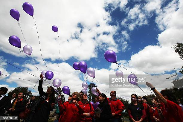 Mill Park Bunnings employees release purple baloons in respect to Britt and her her mother Elke who is an emplyeee at the memorial for Britt...