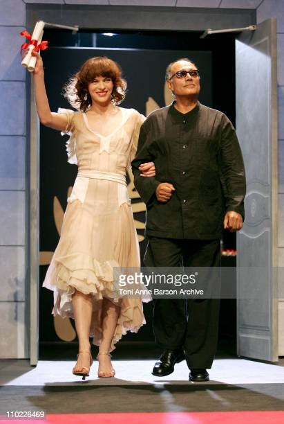 Milla Jovovich and Abbas Kiarostami during 2005 Cannes Film Festival Cannes Awards Inside at Palais de Festival in Cannes France