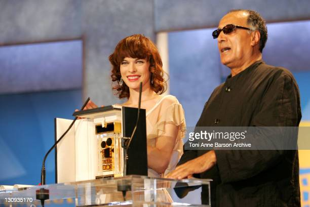 Milla Jovovich and Abbas Kiarostami during 2005 Cannes Film Festival - Cannes Awards Inside at Palais de Festival in Cannes, France.