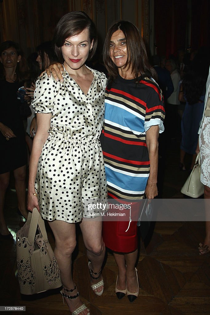 Milla Jovovich and Carine Roitfeld attend the Founder And CEO Alessandro Savelli And Contemporary Style Icon Julia Restoin Roitfeld Launch SAVELLI The World's First Luxury Smart Phone Especially For Women During Haute Couture Week at Musee Jacquemart-Andre on July 3, 2013 in Paris, France.