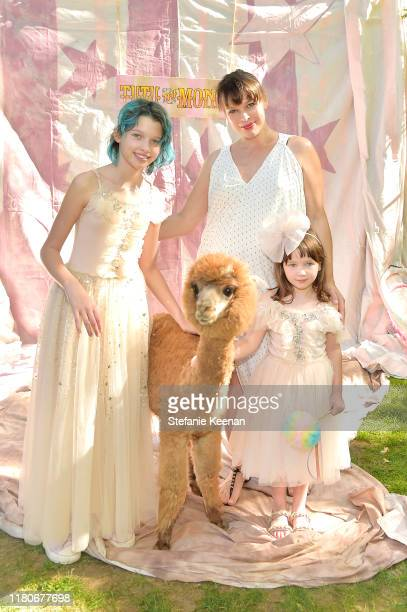 Milla Jovovich and children attend Tutu Du Monde 10th Anniversary Celebration at Private Residence on October 12 2019 in Beverly Hills California
