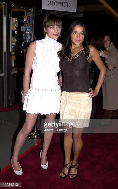 Milla Jovovich and Michelle Rodriguez during 'Resident Evil' Premiere at The Mann Chinette Theater in Los Angeles California United States