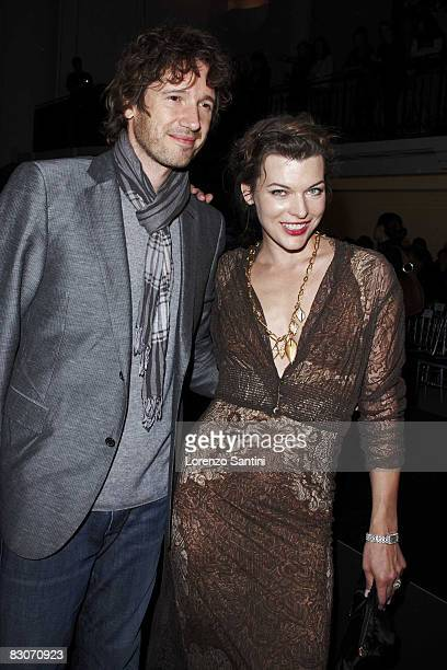 Milla Jovovich and Paul Anderson are seen at the Jean Paul Gaultier fashion show during Paris Fashion Week on September 30 2008 in Paris France