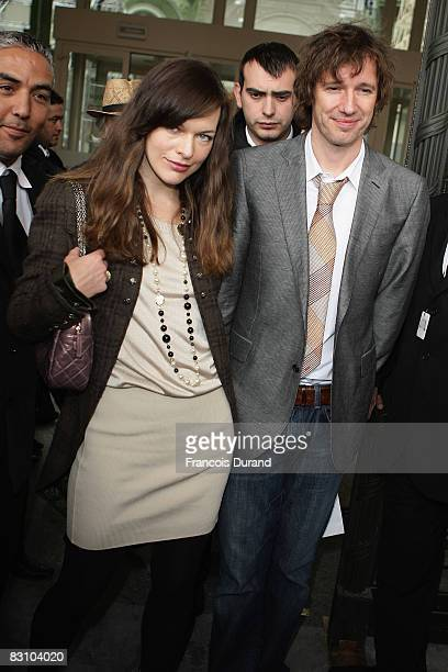 Milla Jovovich and Paul W S Anderson arrive at the Chanel fashion show during Paris Fashion Week at Grand Palais on October 3 2008 in Paris France