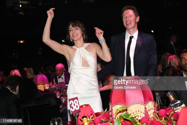 Milla Jovovich and Paul W.S. Anderson attend the amfAR Cannes Gala 2019 at Hotel du Cap-Eden-Roc on May 23, 2019 in Cap d'Antibes, France.