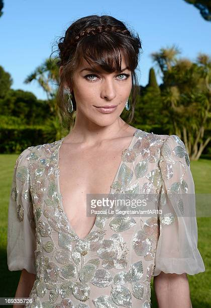 Milla Jovovich attends amfAR's 20th Annual Cinema Against AIDS during The 66th Annual Cannes Film Festival at Hotel du CapEdenRoc on May 23 2013 in...