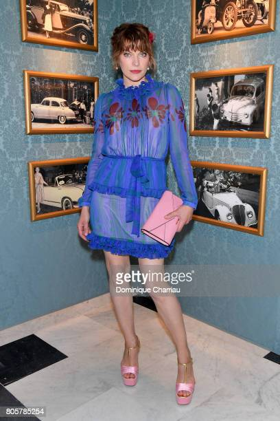 Milla Jovovich attends Miu Miu Cruise Collection show as part of Haute Couture Paris Fashion Week on July 2 2017 in Paris France