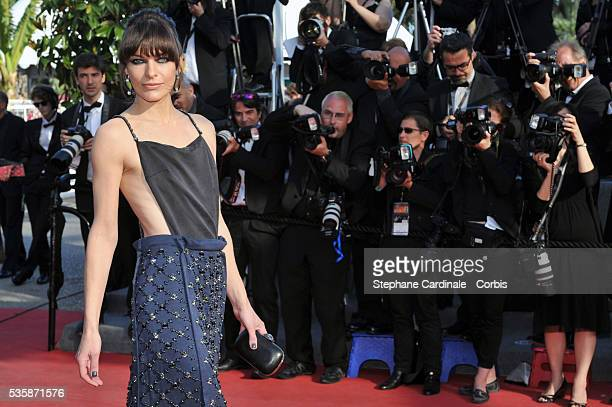 Milla Jovovich attends the 'Behind The Candelabra' premiere during the 66th Cannes International Film Festival.