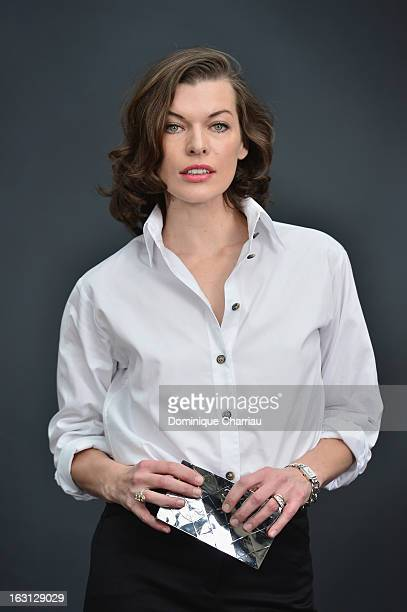 Milla Jovovich attends the Chanel Fall/Winter 2013 ReadytoWear show as part of Paris Fashion Week at Grand Palais on March 5 2013 in Paris France