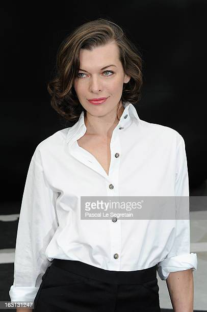 Milla Jovovich attends the Chanel Fall/Winter 2013 Ready-to-Wear show as part of Paris Fashion Week at Grand Palais on March 5, 2013 in Paris, France.