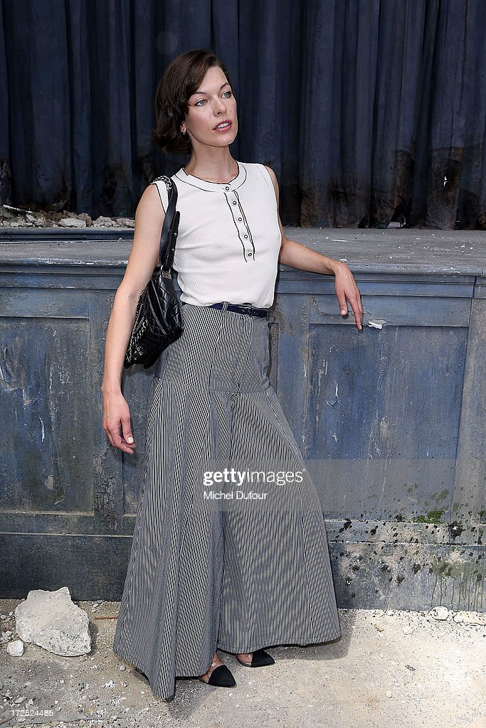 Milla Jovovich attends the Chanel show as part of Paris Fashion Week Haute-Couture Fall/Winter 2013-2014 at Grand Palais on July 2, 2013 in Paris, France.