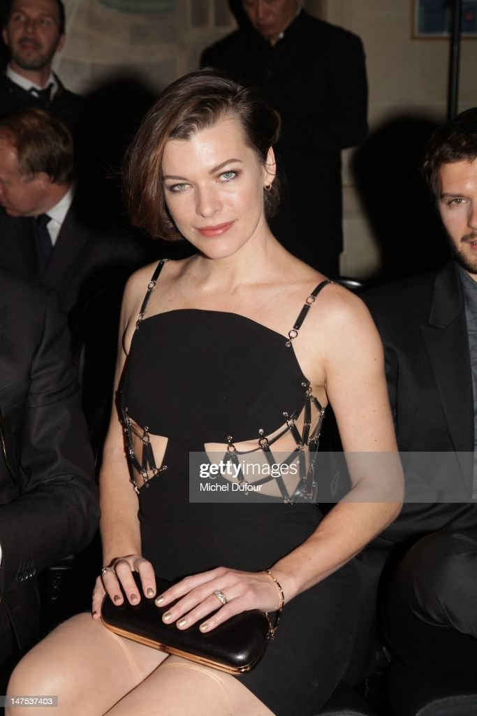 Milla Jovovich attends the Versace Haute-Couture Show as part of Paris Fashion Week Fall / Winter 2012/13 on July 1, 2012 in Paris, France.