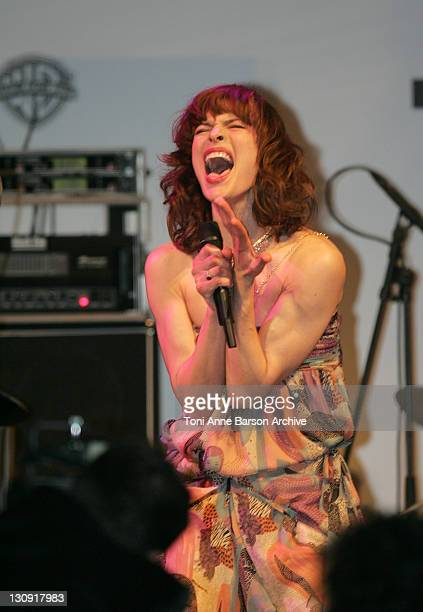 """Milla Jovovich during amfAR """"Cinema Against AIDS"""" Gala Presented By Miramax Films, Palisades Pictures and Quintessentially - Auction at Le Moulins de..."""
