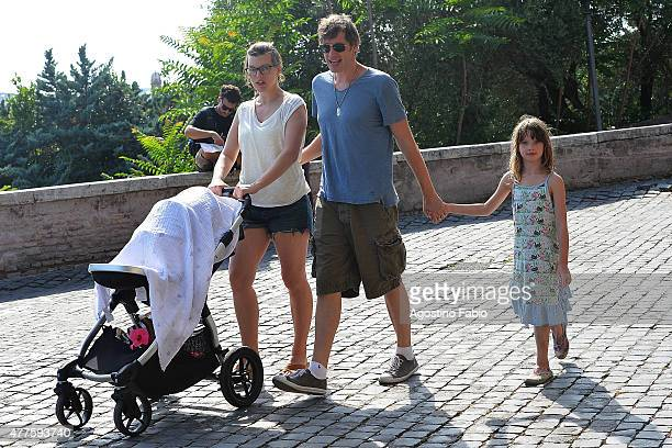 Milla Jovovich is seen in Rome with husband Paul W S Anderson daughter Ever Gabo and 3 months old daughter Dashiel Edon on June 18 2015 in Rome Italy