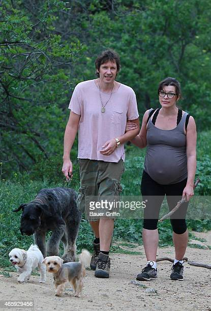 Milla Jovovich Paul WS Anderson and her three dogs are seen on March 11 2015 in Los Angeles California