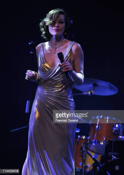 Milla Jovovich performs onstage at amfAR's Cinema Against AIDS Gala during the 64th Annual Cannes Film Festival at Hotel Du Cap on May 19, 2011 in...