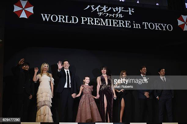 Milla Jovovich poses on stage with cast at the world premiere of 'Resident Evil The Final Chapter' at the Roppongi Hills on December 13 2016 in Tokyo...