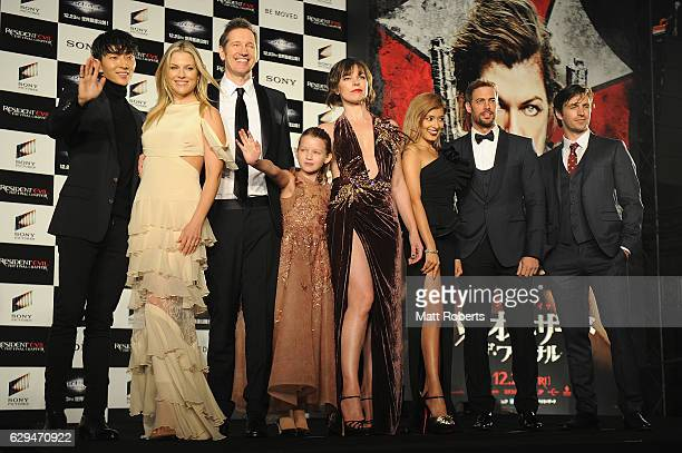 Milla Jovovich speaks on poses on stage with cast at the world premiere of 'Resident Evil The Final Chapter' at the Roppongi Hills on December 13...