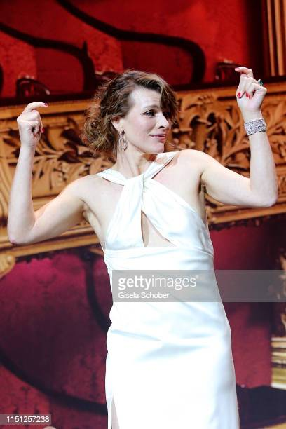 Milla Jovovich speaks on stage during the amfAR Cannes Gala 2019 at Hotel du Cap-Eden-Roc on May 23, 2019 in Cap d'Antibes, France.