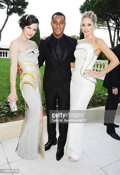 Milla Jovovich Sunnery James and wife Doutzen Kroes attend the 2012 amfAR's Cinema Against AIDS during the 65th Annual Cannes Film Festival at Hotel...