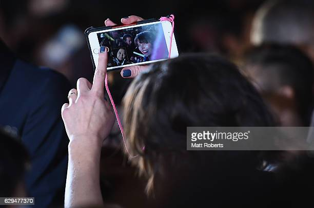 Milla Jovovich takes a selfie with a fan at the world premiere of 'Resident Evil The Final Chapter' at the Roppongi Hills on December 13 2016 in...