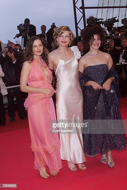Milla Jovovich Virginie Ledoyen and Ana Paula Arosio arrive at the Palme d'Or Award Ceremony at the 54th Cannes Film Festival in Cannes France Photo...