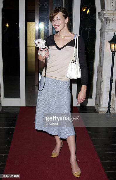 Milla Jovovich with her dog Madness during 2002 Venice Film Festival Milla Jovovich Arrives in Venice to Host the amfAR Gala at Bauer Hotel in Venice...