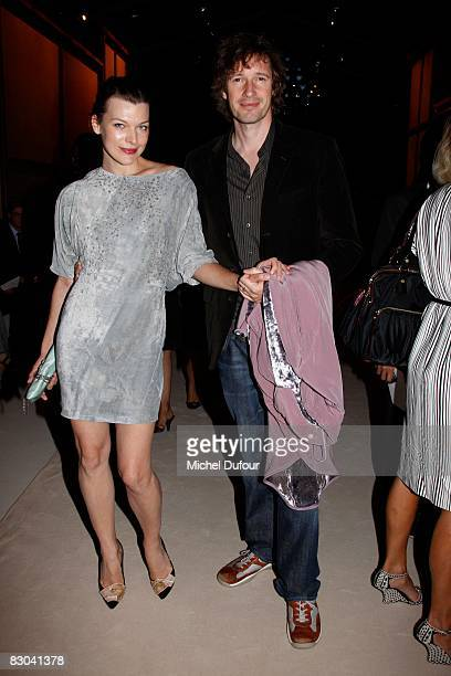 Milla Jovovitch and Paul Anderson arrives at the Nina Ricci PFW Spring/Summer 2008 show on September 28 2008 in Paris France