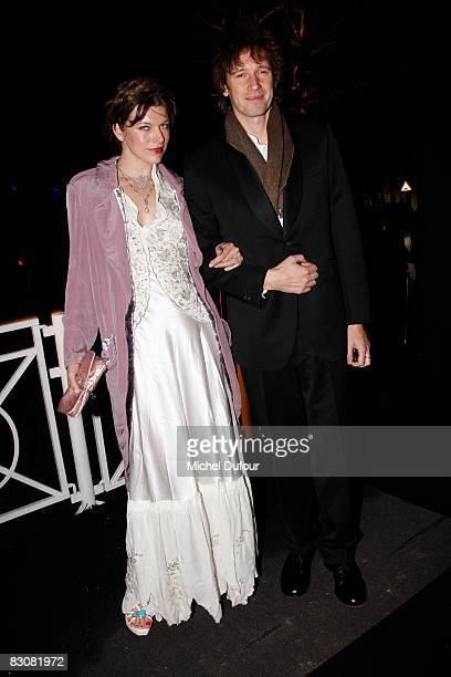 Milla Jovovitch and Paul Anderson attend the Sonya Rikiel fashion show during Paris Fashion Week on October 1 2008 in Paris France