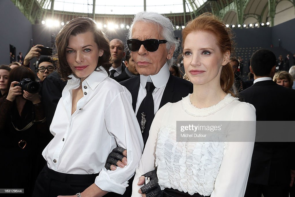 Milla Jovovitch, Karl Lagerfeld and Jessica Chastain attend the Chanel Fall/Winter 2013 Ready-to-Wear show as part of Paris Fashion Week at Grand Palais on March 5, 2013 in Paris, France.