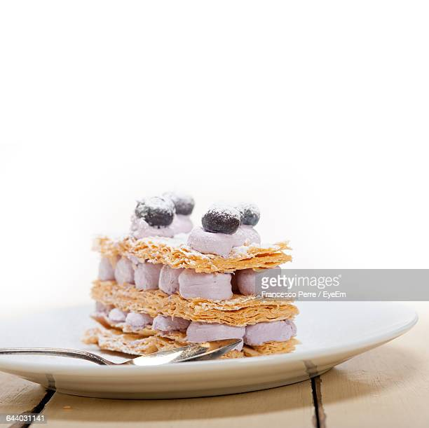 Mille Feuille With Blueberries And Cream On Table